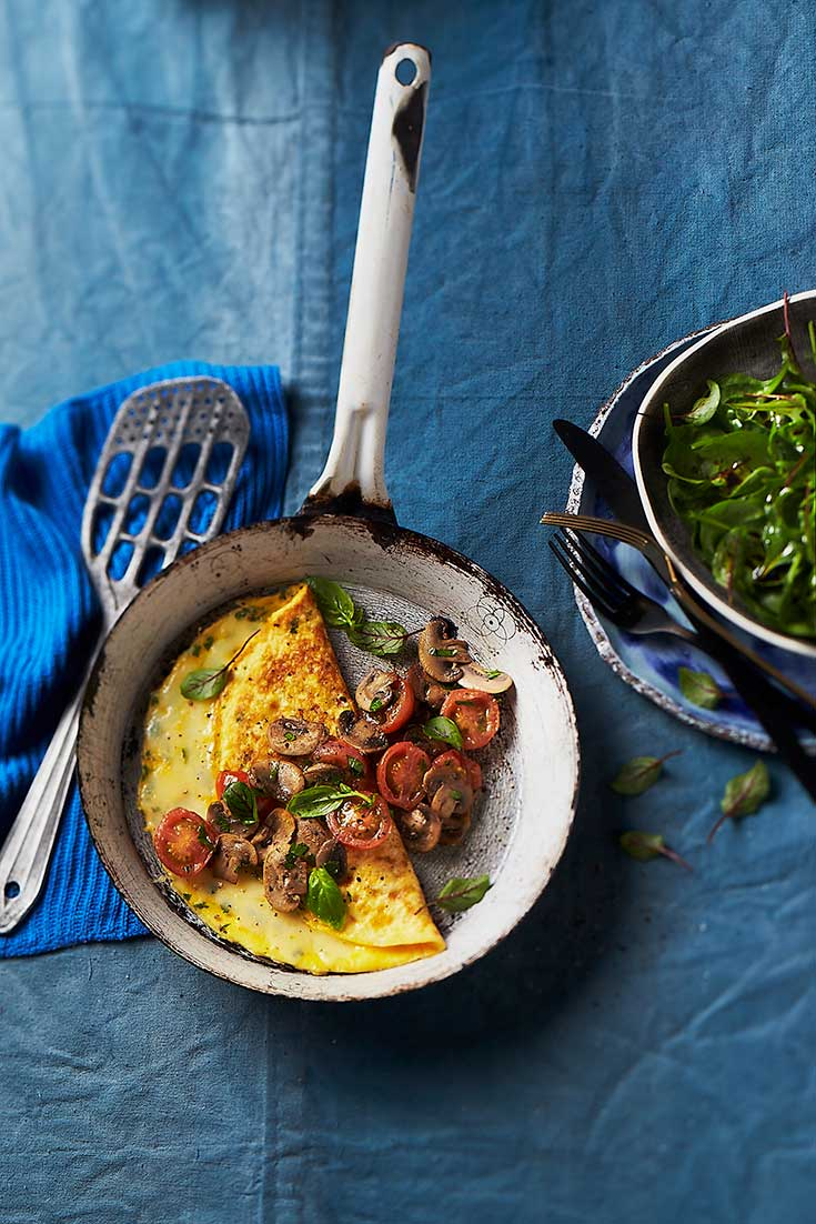 This easy mushroom and tomato omelette can be enjoyed for breakfast or dinner.