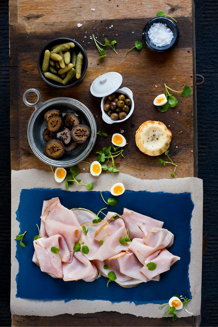 Simple Leg Ham and Baked Ricotta Platter with Quail Eggs and Pickled Walnuts
