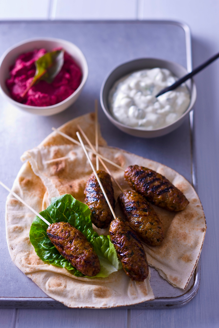 Start cooking turkey for dinner with ideas like this Turkey Kofta wrapped in Lebanese bread, served with dips