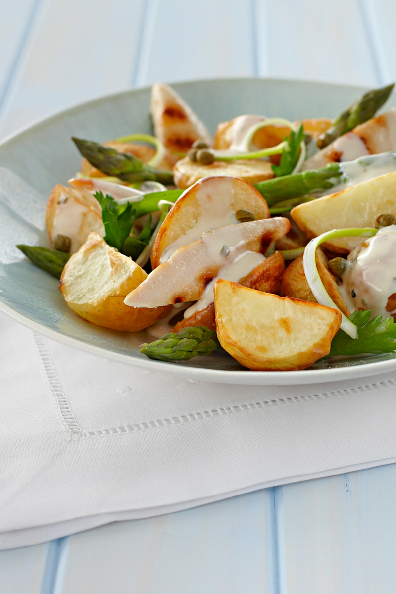 Fresh and delicious potato salad with chicken and asparagus