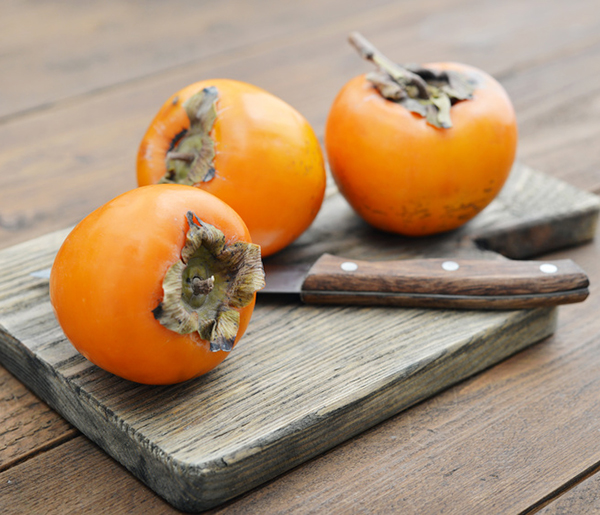 Fresh and ripe sweet persimmons. Get tips and tricks for preparing persimmons here.