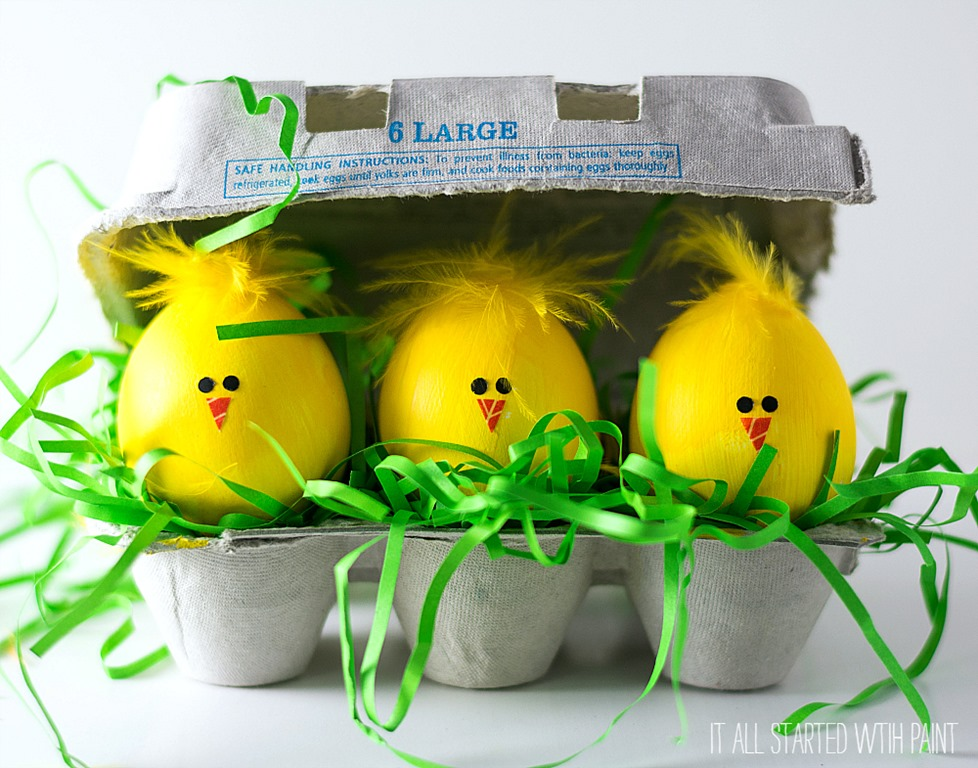 Using paint instead of dye is an easier way for kids to decorate eggs this Easter