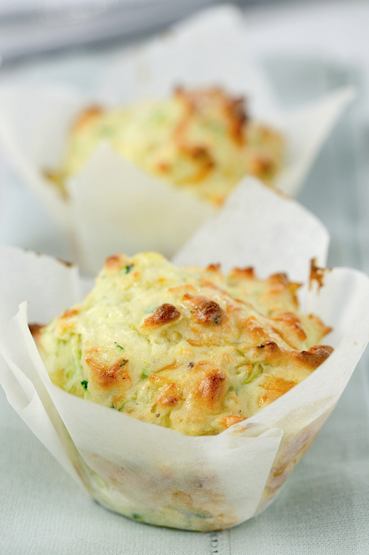 Make a batch of cheesy corn and zucchini muffins using leftover milk for a lunch idea that is easy and delicious