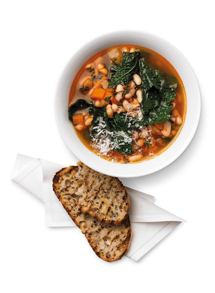 This kale and bean soup recipe is easy to make in your slow cooker or your pressure cooker. Try this idea for a warming winter dish.