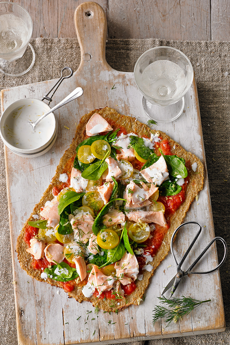 Get cooking with cauliflower with this great recipe for Poached Salmon and Lemon Caper Pizza with a cauliflower base