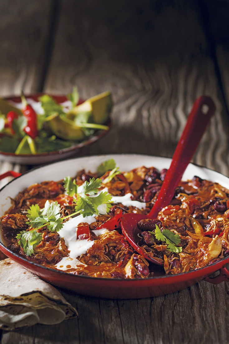 This hearty chicken chilli con carne recipe is one delicious way to eat avocados during winter.