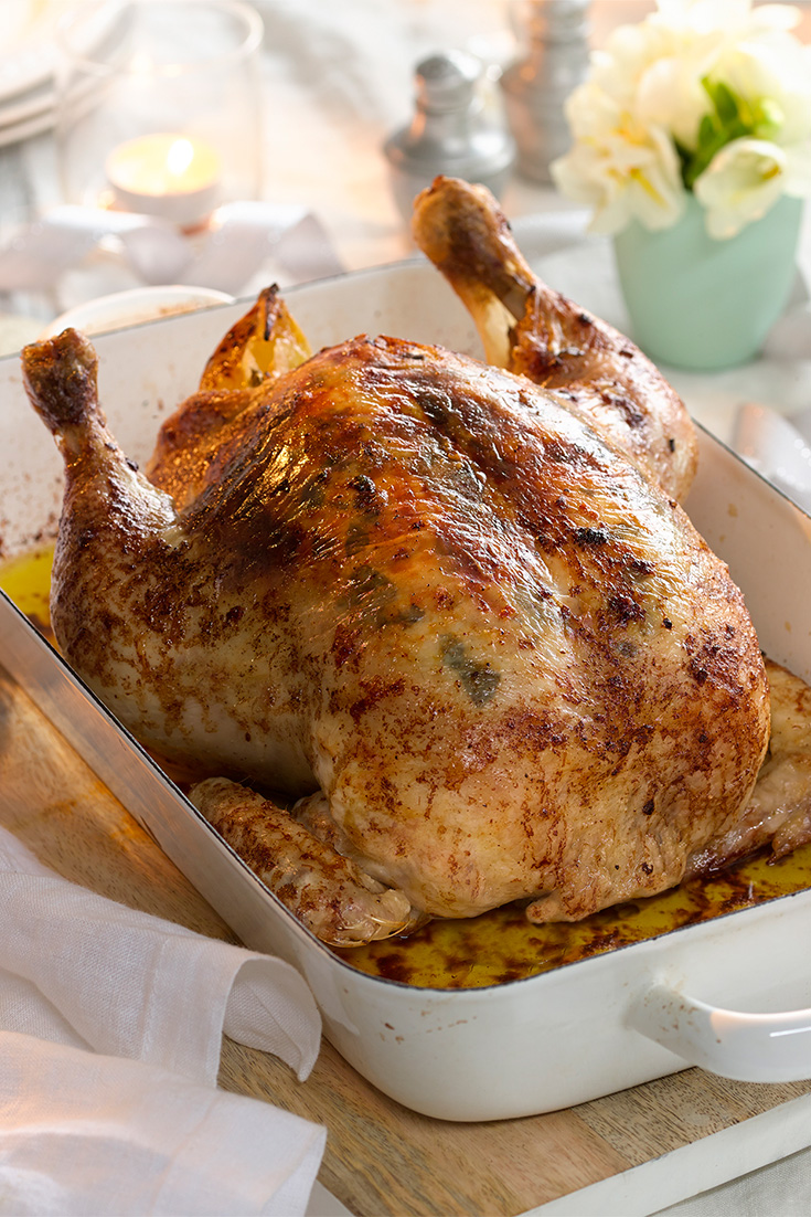 Create the perfect roast chicken skin by cooking with butter.
