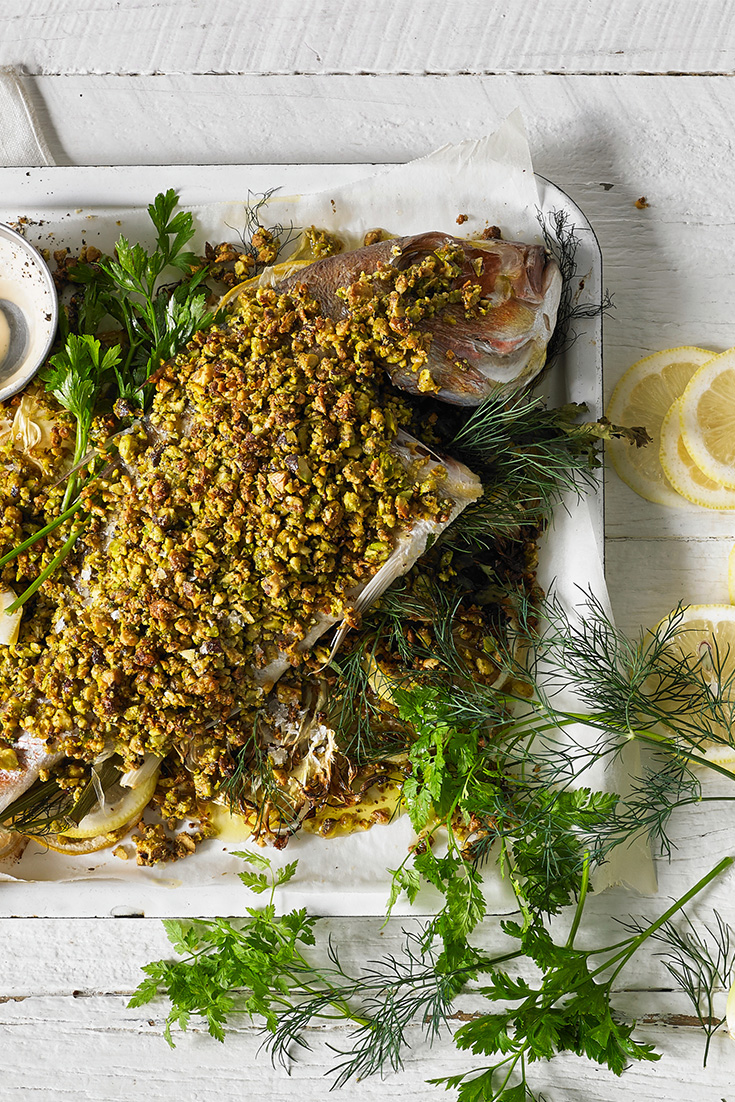 Make a baked snapper recipe and serve with roast potatoes