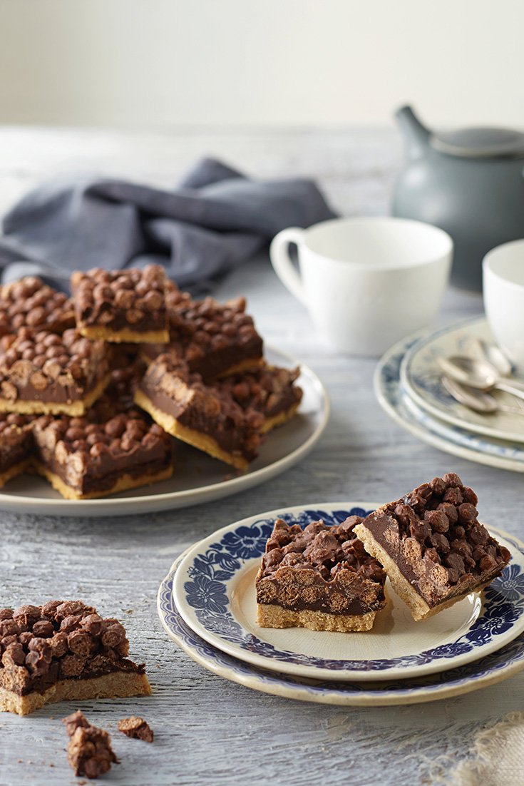 Make a chocolate crackle slice with chocolate ganache for a perfect party treat