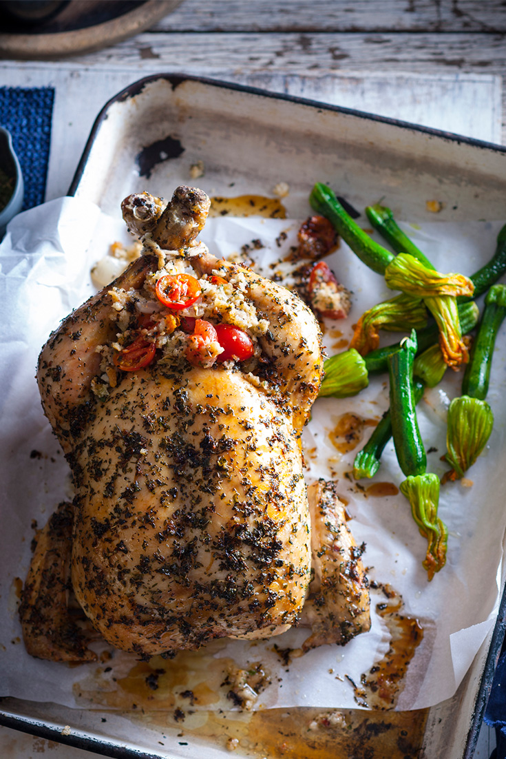 Serve this herb rub roast chicken recipe with crispy smashed potatoes for a great dinner party idea