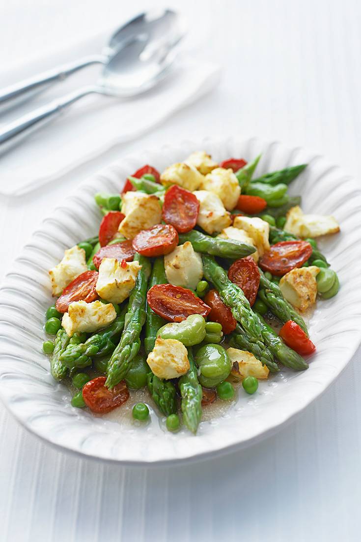 This oven roasted tomato and asparagus salad is an easy way to cook asparagus this spring