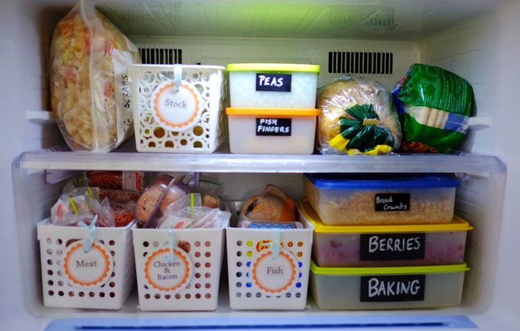 Organise your freezer with containers and dividers. Image via The Organised You