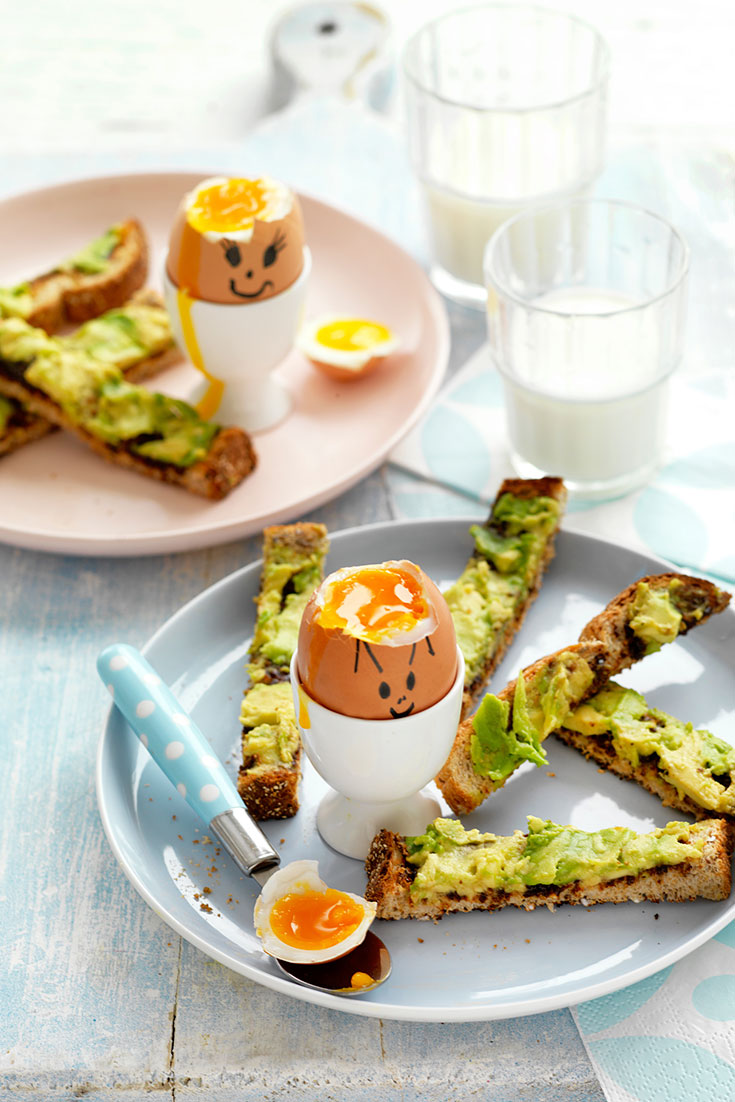 Turn your soft boiled egg recipe into this fun idea for funny face eggs with avo and Vegemite dipping soldiers