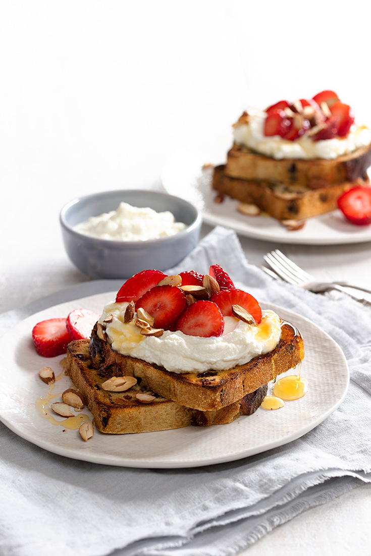 Dress up your fruit toast with delicious ricotta, strawberries and a drizzle of honey