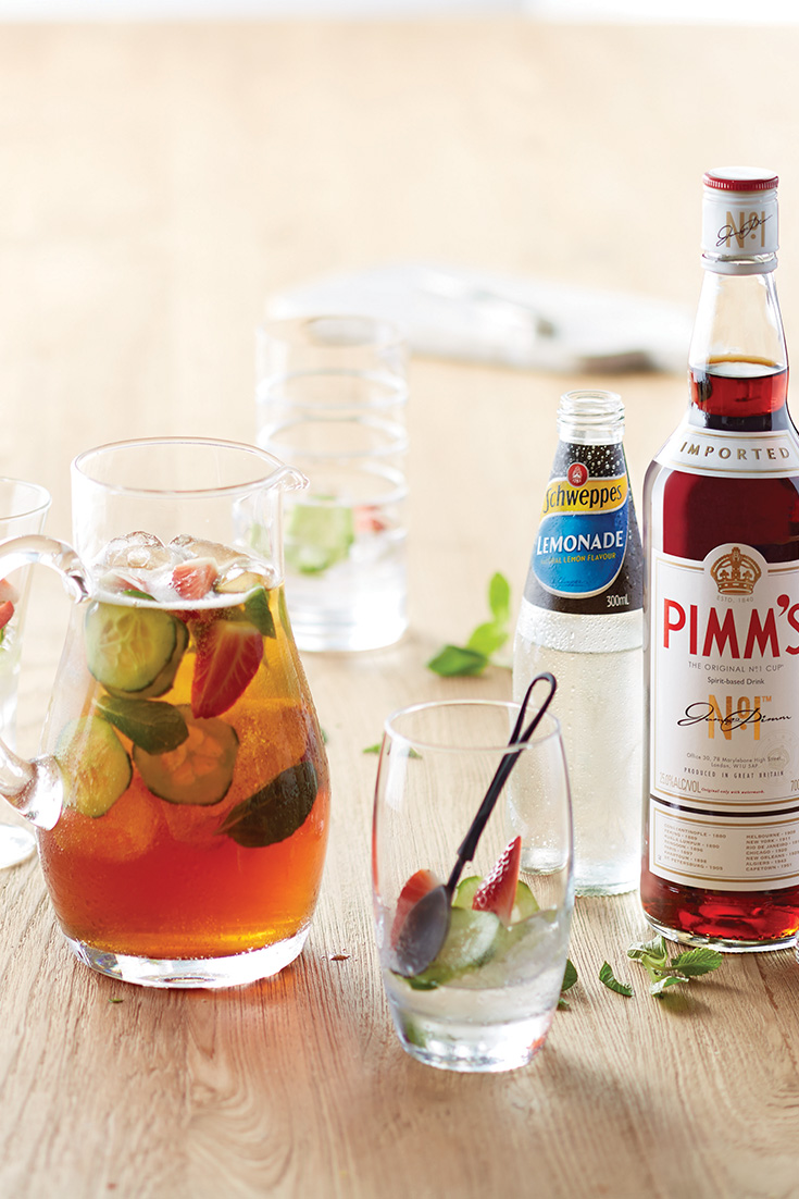 Make a pimms cocktail recipe with Schweppes lemonade and fresh strawberries, cucumber and lime