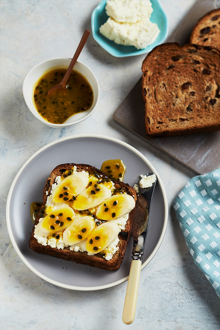 Dress up simple fruit toast with ricotta, banana and passionfruit sauce