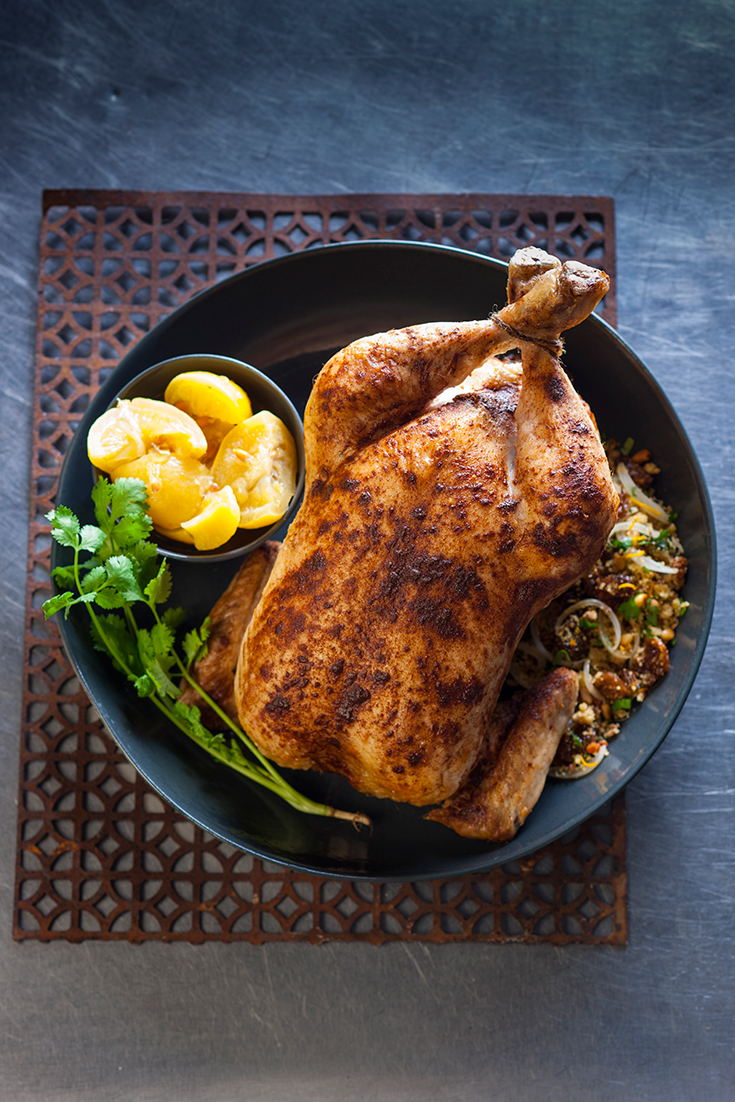 Serve this Chicken Roast filled with Couscous, Raisin and Pine Nut Stuffing for your next family dinner