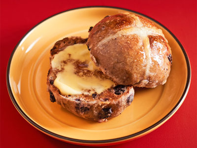Traditional Hot Cross Buns with butter