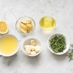 Marinade ingredients for lamb, garlic and rosemary marinade