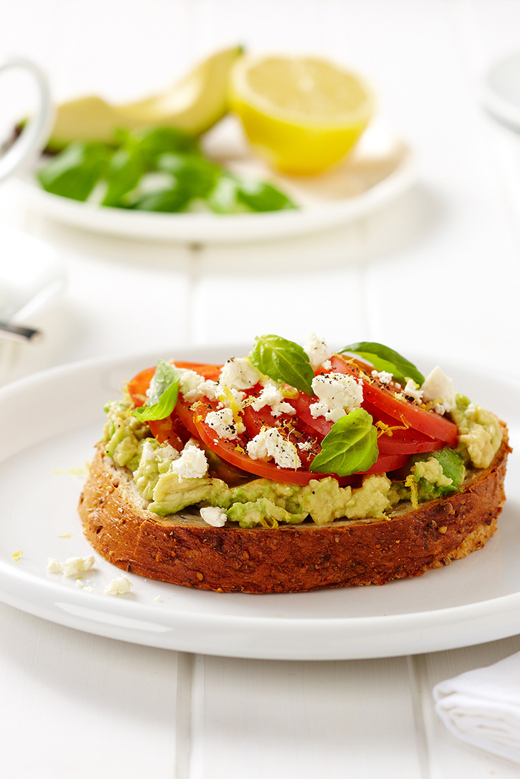Serve fresh avocado and tomato on toast with a sprinkle of feta. A great idea to take you from breakfast through to a simple dinner