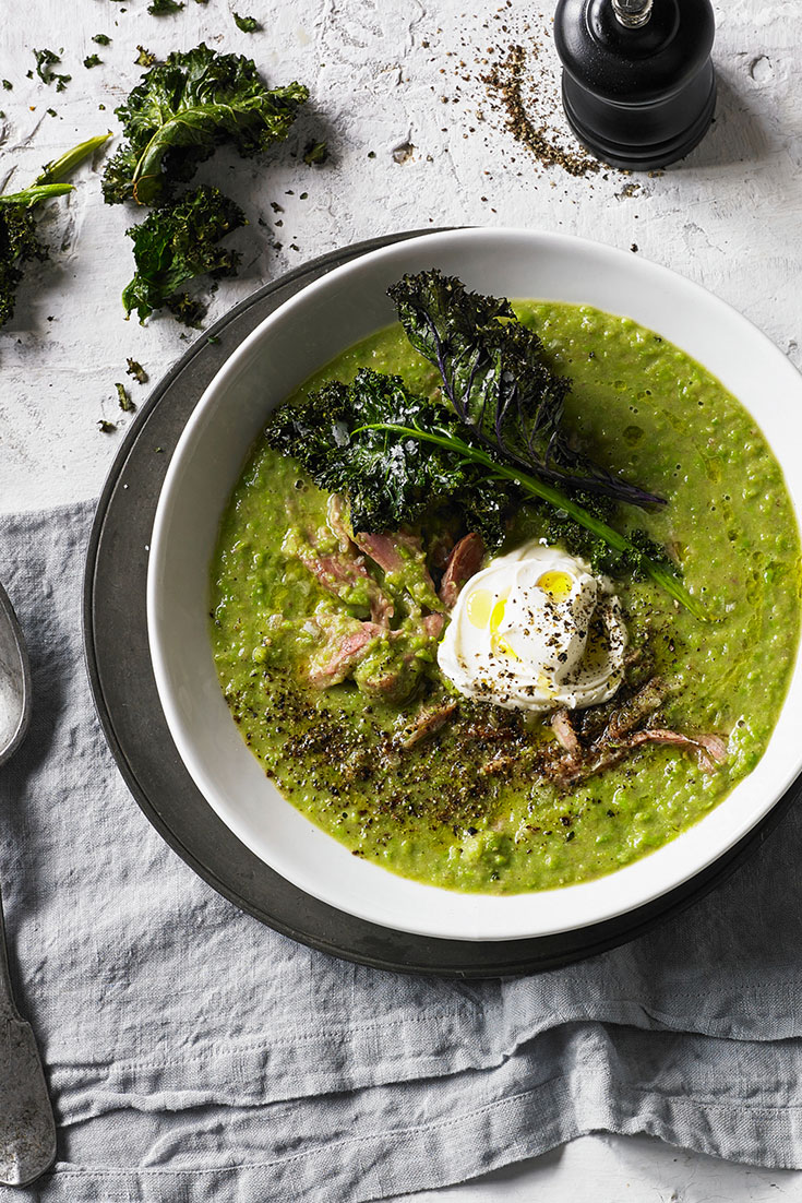 This beautiful split pea and smoked ham soup with kale chips is the ultimate better for you dish to add to your comfort food recipes collection.