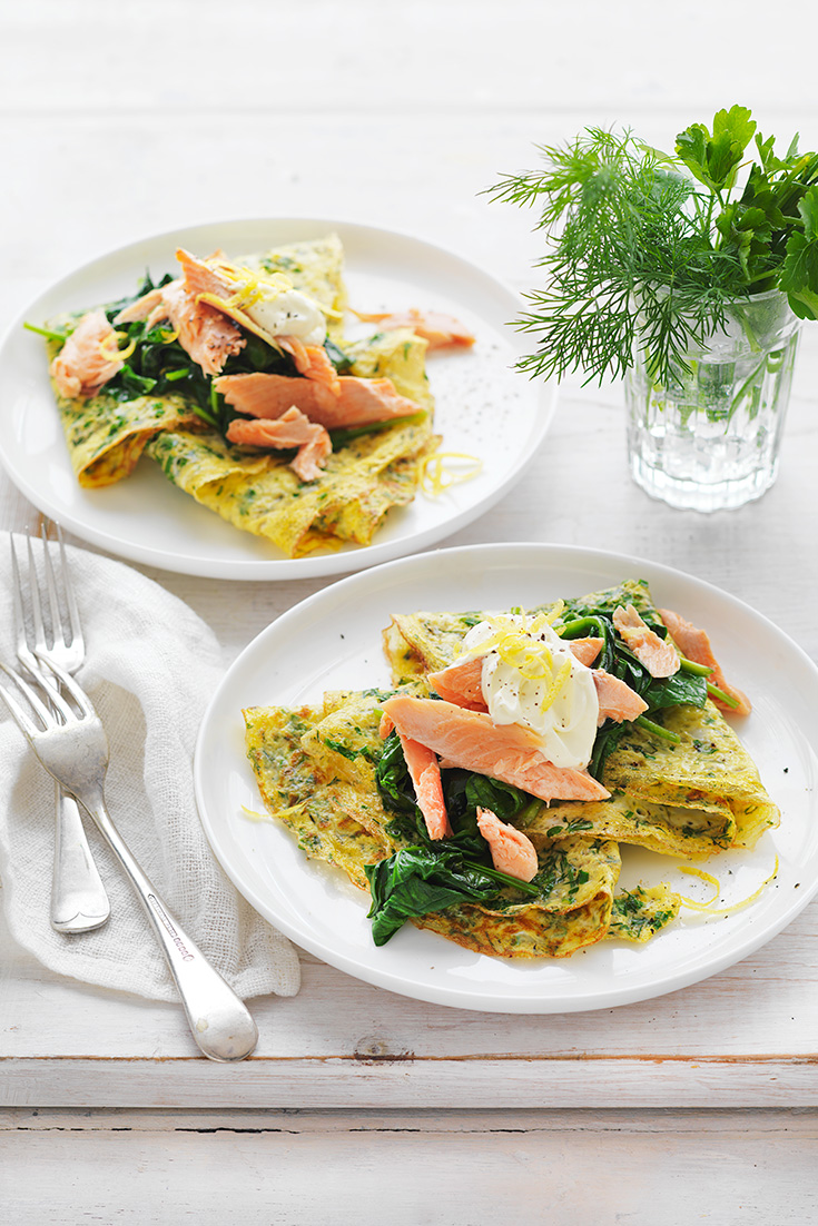 Herb omelettes with wilted spinach and smoked fish is the perfect breakfast idea for mum