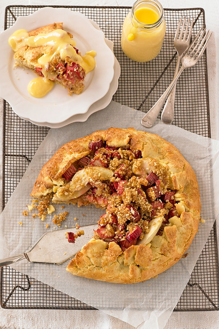 This stunning free-form apple, rhubarb and crumble tart is the perfect winter entertainers dessert.