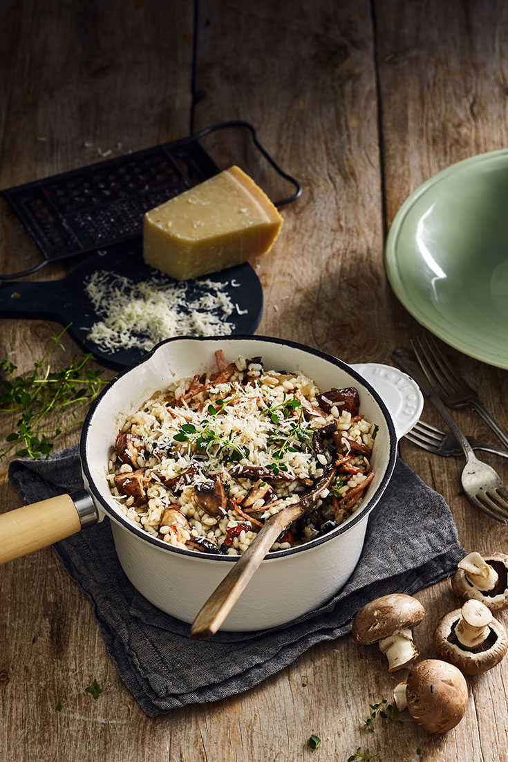 This scrumptious one-pan creamy mushroom risotto topped with crispy bacon will be loved by all who try.
