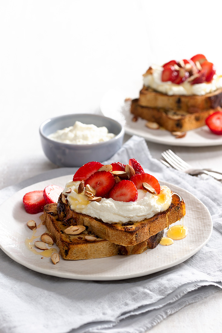 This delicious honeyed ricotta on fruit bread with strawberries recipe is a fanatic winter breakfast idea for something sweet.