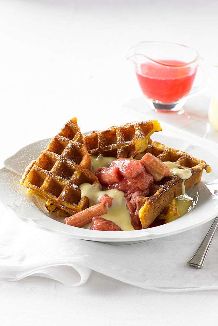 This extremely decadent poached rhubarb and vanilla custard waffle is the perfect winter dessert.