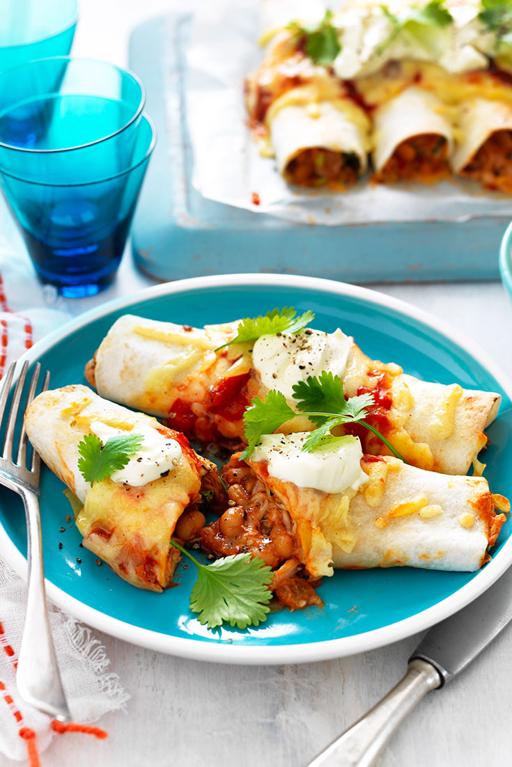This baked bean and chicken enchiladas recipe is a fantastic idea for a weeknight dinner idea.