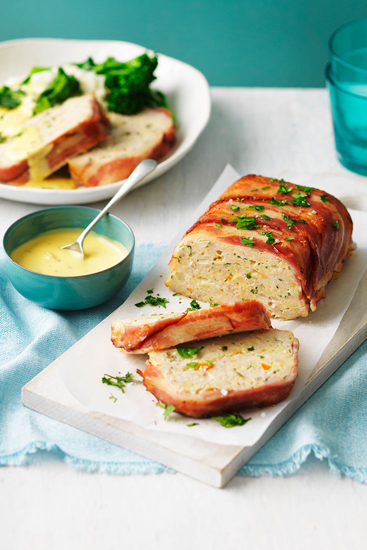 This easy chicken meatloaf wrapped in streaky bacon recipe is the perfect family dinner idea.