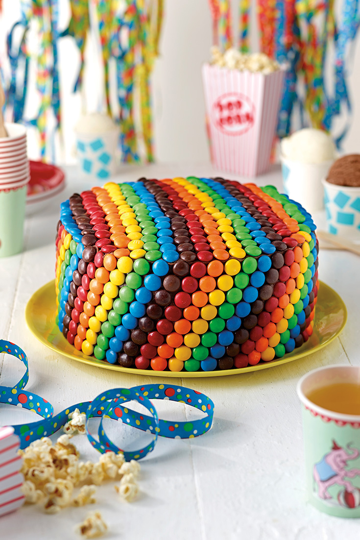 This fun rainbow teacake recipe with vanilla frosting and M&Ms is the ultimate kids party dish which will be loved by all.