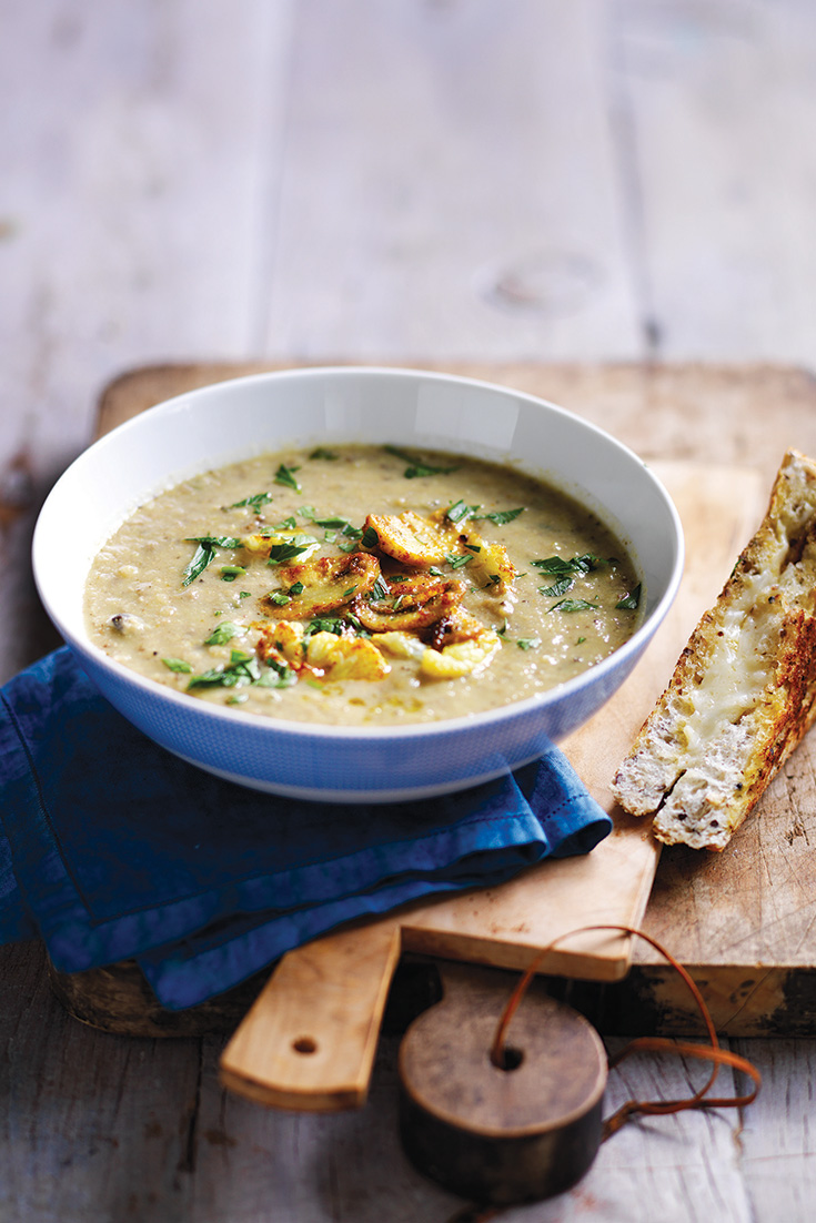 This easy roasted mushroom and cauliflower soup recipe is a delicious vegetarian dinner idea.