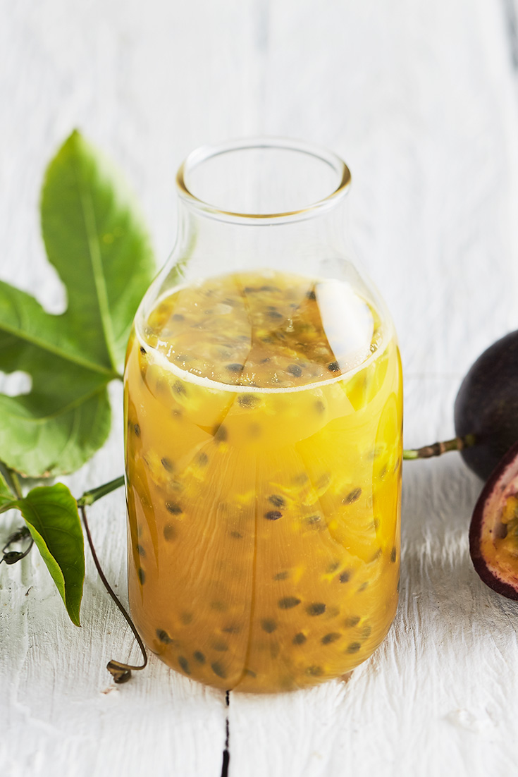 This easy tangy passionfruit sauce recipe is perfect to drizzle over ice cream and other fruits for a quick and easy mid-week dessert.