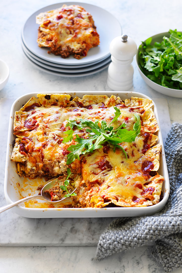 This nacho lasagne recipe is the perfect family dinner idea and using corn chips will add an extra crunch.