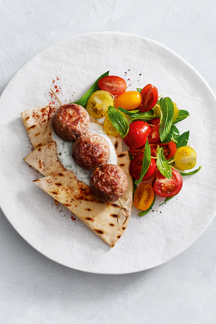 This easy turkey kebabs with flatbread recipe is an easy family dinner idea and served with a mixed tomato and mint salad. It is a great spring and summer dish.