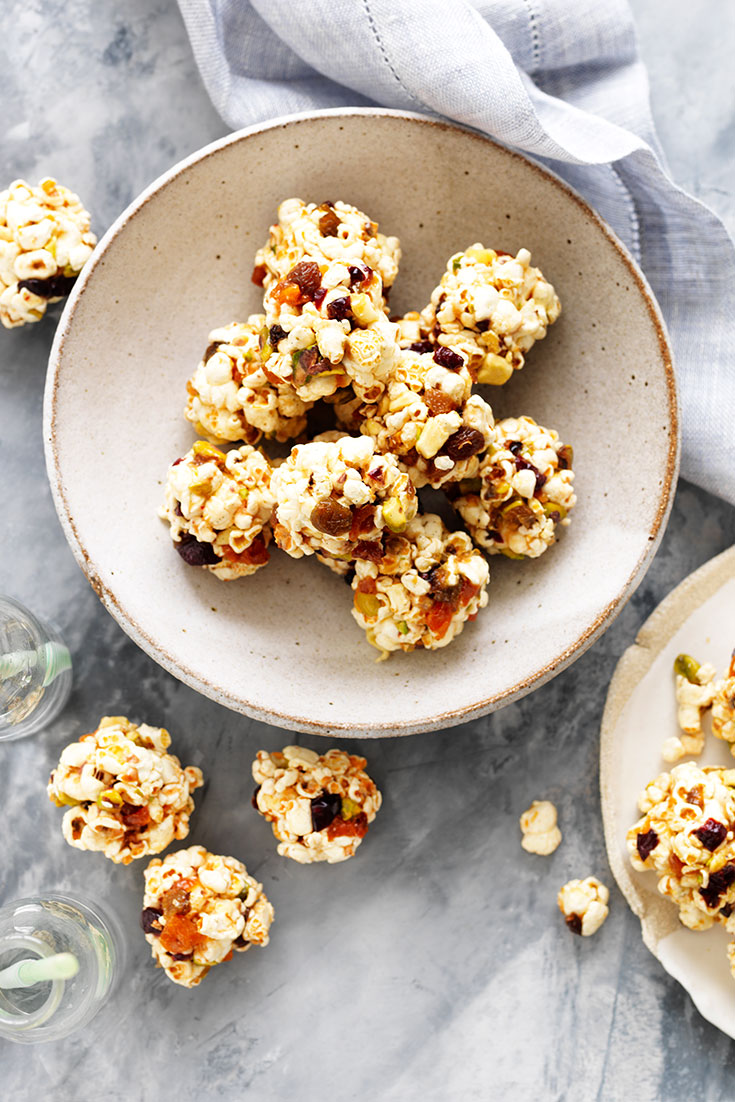This easy fruit and nut popcorn balls recipe make for a tasty snack.