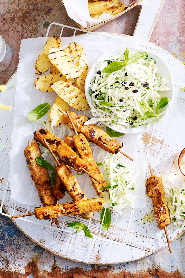 This easy satay chicken skewers recipe with apple coleslaw and kipfler potatoes is the perfect crowd-pleasing BBQ dish.