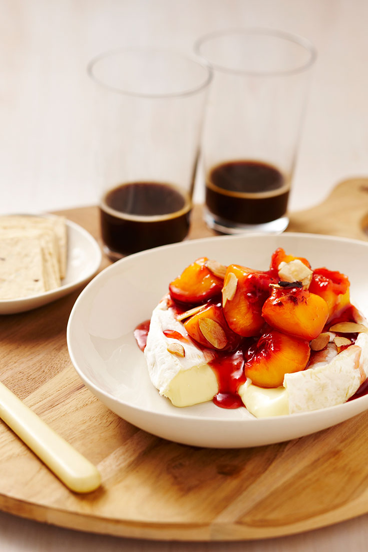 This stunning camembert with peach and clove relish and almonds recipe is a tasty gourmet cheese appetiser.