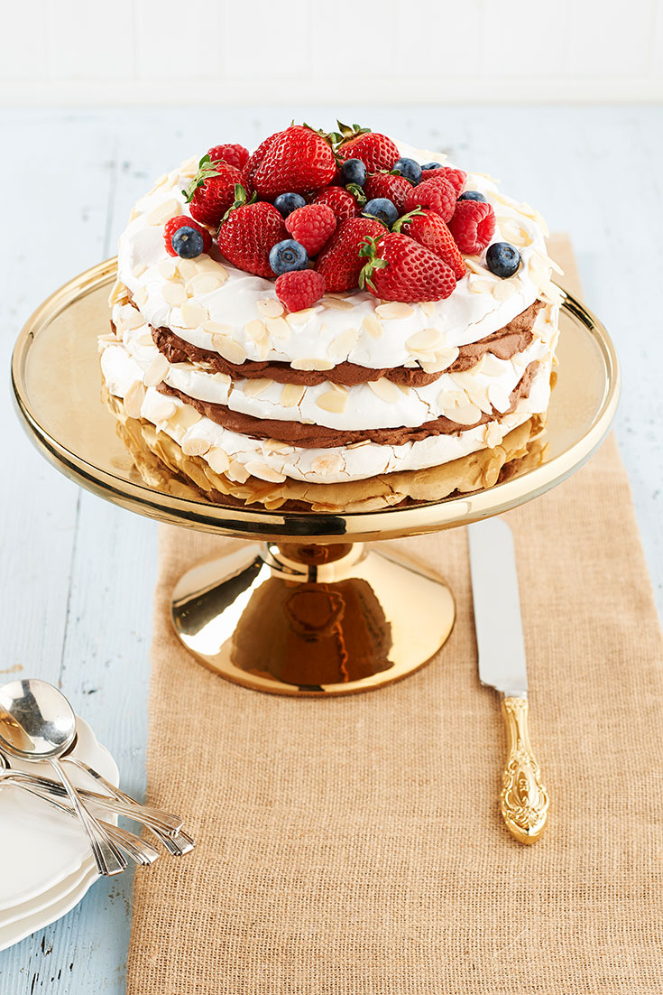 This stunning layered pavlova with chocolate marsala cream recipe is the perfect dessert to serve on Christmas Day to impress family and friends.