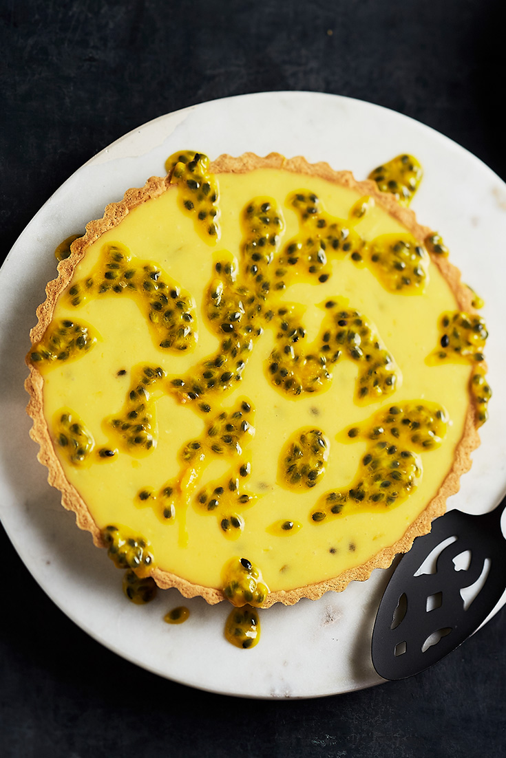 This stunning passionfruit tart recipe is the perfect in season this summer dessert recipe