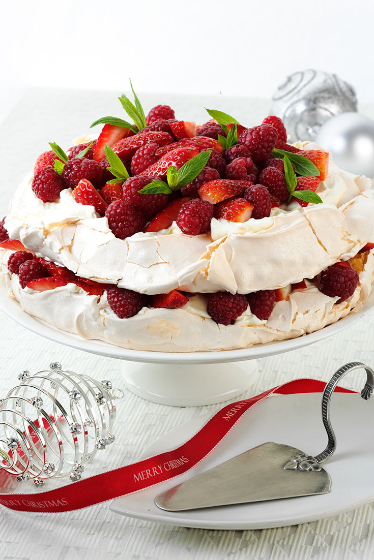 This stunning Aussie pavlova layer cake with red berries is the perfect festive dessert.