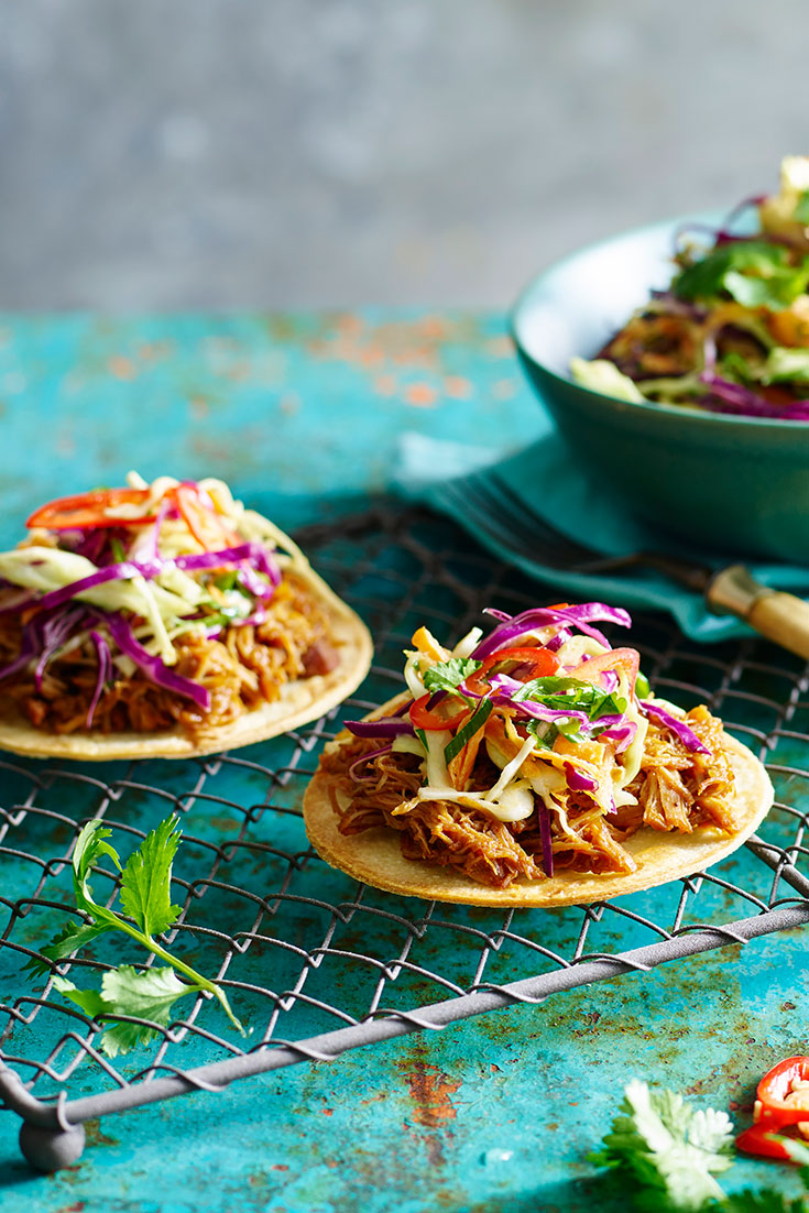 This super tasty pulled chicken tostada with slaw recipe is a great dish for guests to serve themselves when dining outdoors.
