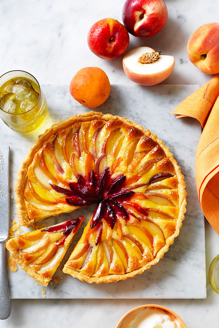 This stunning layered stone fruit tart recipe is the perfect dessert for entertaining.