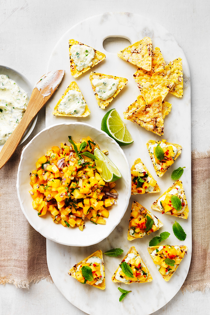 This easy corn chip bruschetta with mangoes and herb ricotta recipe is tasty and colourful appetiser.