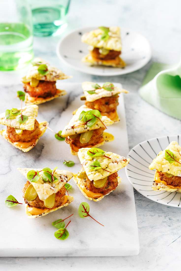 This easy corn chip sliders with crumbed fish patties recipe is the perfect summertime entertaining appetiser.