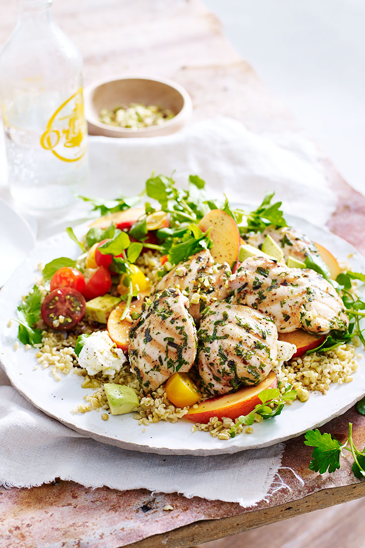 This chargrilled herb chicken with freekeh and peach salad is a great dish to serve up at a BBQ.