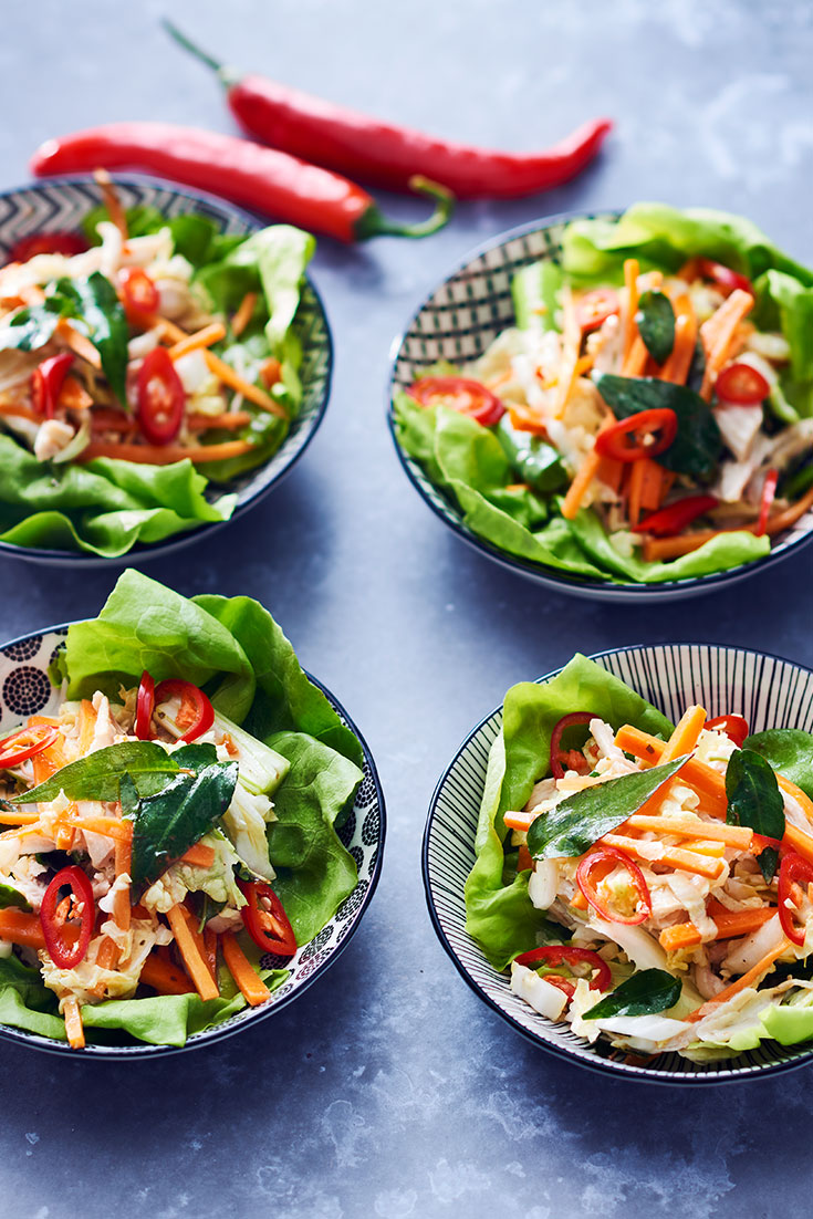 This easy asian poached chicken slaw in lettuce cups recipes is the perfect dinner for when it's too hot.