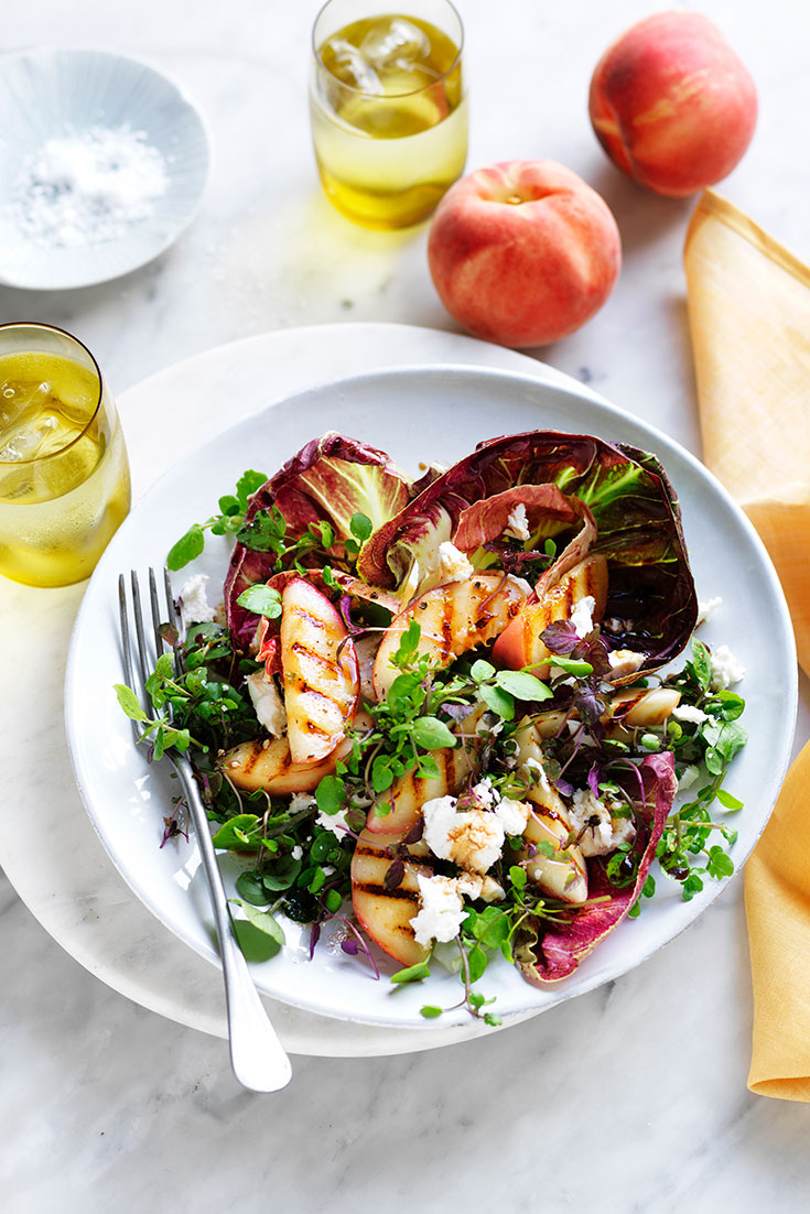 This easy grilled white peach, radicchio and goats cheese salad recipe is the perfect summer salad.